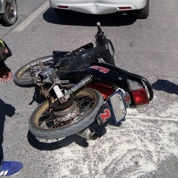 A motorcycle crashed behind a sedan damaging its rear. Car owner decides to compensate for the rider.