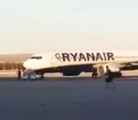 Watch hilarious video of a man catching his plane by foot!