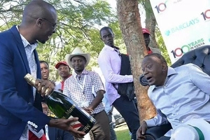 Uhuru DRINKS a tall pitcher or beer at his son's wedding (photo)