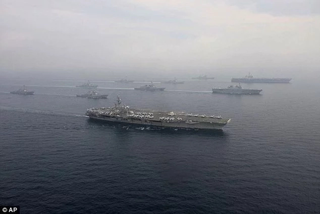 USS Ronald Reagan (front) and USS Carl Vinson (far right) conducted drills in the Sea of Japan