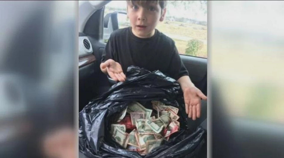 7-year-old boy finds bag full of CASH, brings back to owners (photos, video)