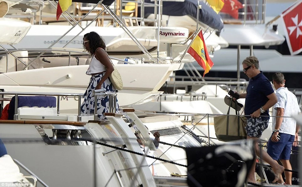 Michelle Obama getting on board a yacht in Mallorca, Spain. Photo: Splash News