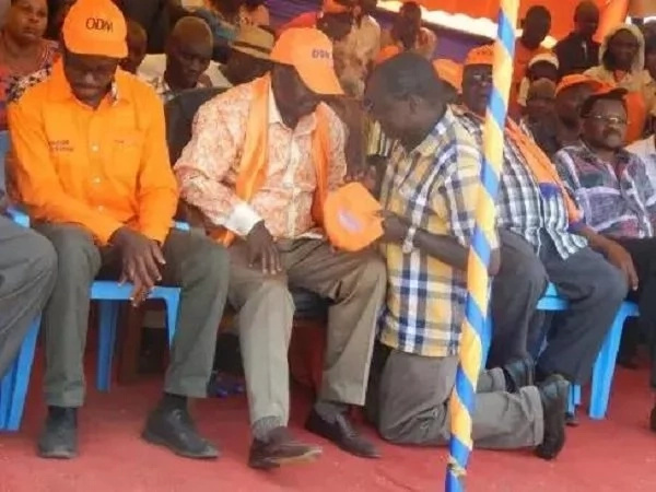 A controversial photo of an ODM aspirant kneeling before Raila