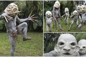 Mud men! See fearsome tribesmen who wear SCARY clay masks to intimidate rival tribes (photos)