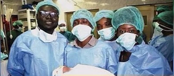 Doctors pictured with the healthy baby boy. Photo: Africanews.com