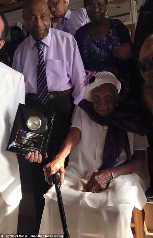 Harold Fairweather (left) seen with his mother, who is the world's oldest person, in a recent photo