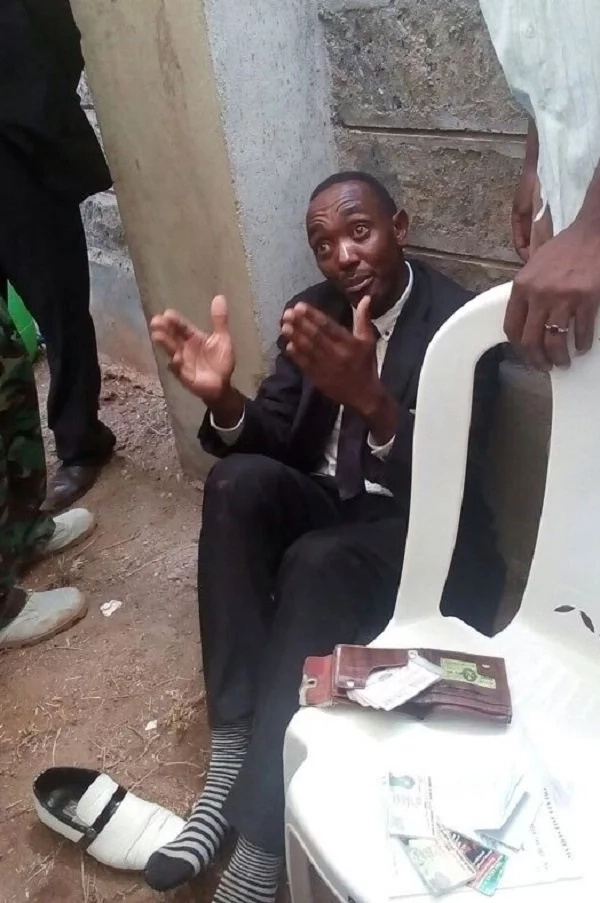 Drama as man disrupts burial of Nkaissery, claims he was sent to resurrect him