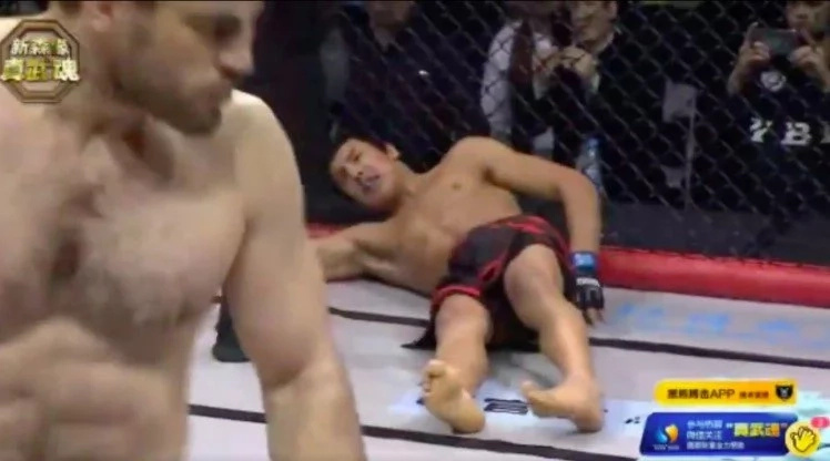 MMA Fighter Cheap Shots His Opponent With A Fake Glove Touch