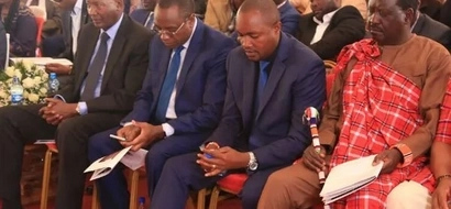Raila tells off Nkaissery when they met at John Keen's burial in Namanga