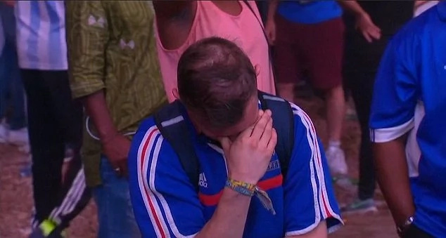 Portuguese boy consoles a French fan after Euro 2016 loss