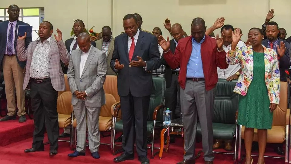 Uhuru and Ruto praying at the church service