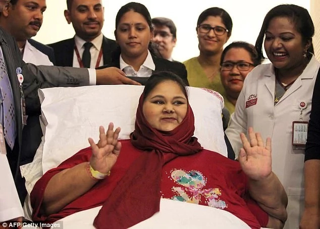 Eman waves during a press conference upon her arrival in Abu Dhabi in July. Photo: Getty Images