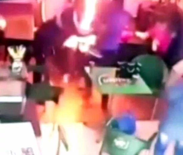 Man sets wife ON FIRE in front of his 2 horrified children in crowded restaurant (photos, video)