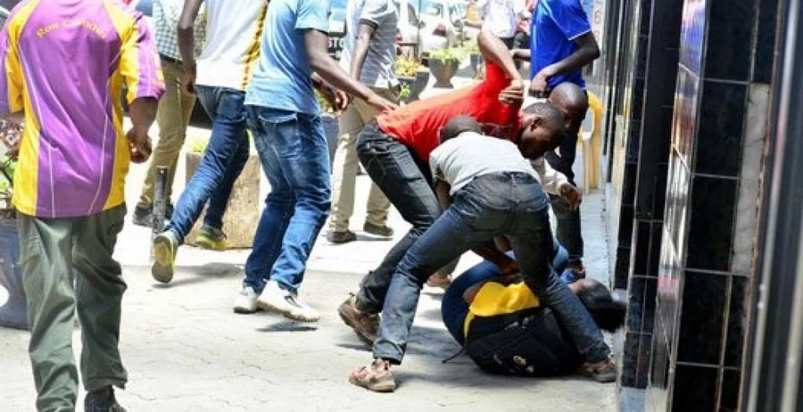 Robbers attacking a pedestrian along the busy Nairobi streets.
