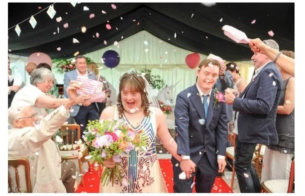Here comes the bride: Beautiful love-story and down's syndrome wedding with singing, dancing and unicorn throne