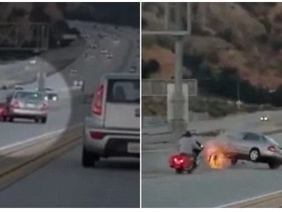 Biker aggressed car driver while driving. His move caused such a tragedy that traffic had to stop