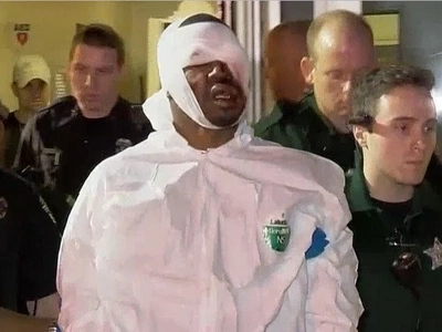 Cop Killer Screams That Police Beat Him Up As He Is Dragged Around In Victims Handcuffs