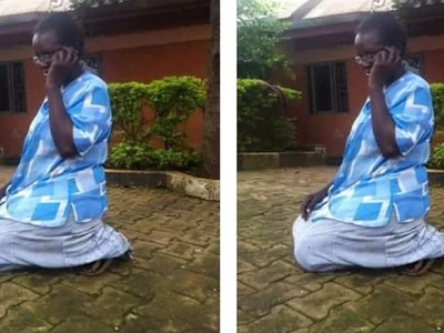 A Ugandan woman has caused an uproar when a photo of her speaking while kneeling.