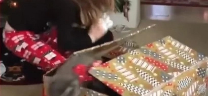 A Little Girl Gets The Sneakiest Cat For Christmas