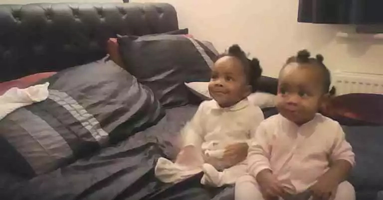 See how mom starts singing when suddenly her twins into action