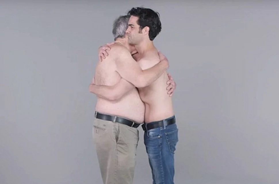 See strangers cuddling each other while topless in bizarre new social experiment (photos/video)