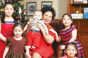 Sen. Miriam poses with husband, grandkids; thanks supporters