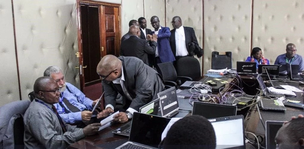 Raila Odinga agents pictured going through IEBC documents as Supreme Court battle nears the end