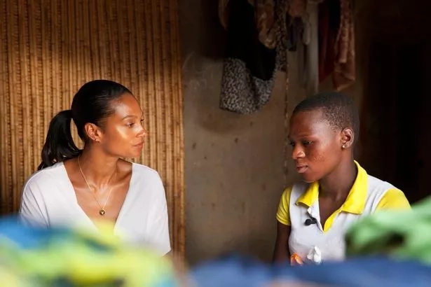 Juliette shares her experience with Alesha. Photo: Abbie Trayler-Smith/ActionAid/PA