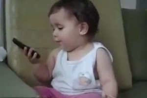 This Brilliant Baby Pretends To Be Talking On Mother's Phone In The Most Adorable Way