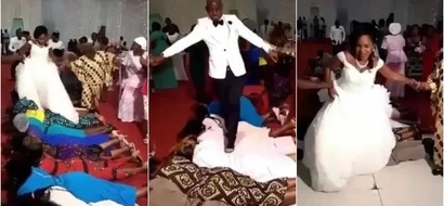 This beautiful couple seen walking on guests at their wedding ceremony (photos)