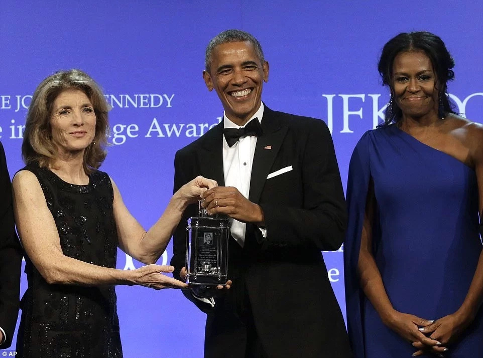 Caroline Kennedy presents the Award to former President Obama as former First Lady Michelle looks on