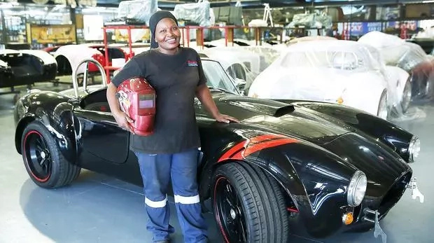 Zandile poses next to one of the Roadsters she has built. Photo: IOL News