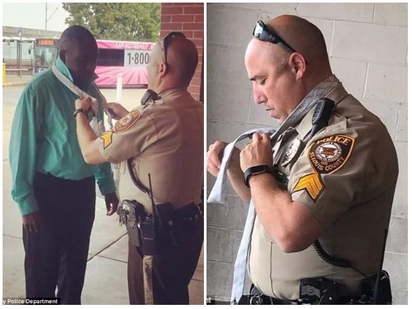 Rare moment white cop helps black man tie a tie on his way to job interview amid anti-police protest