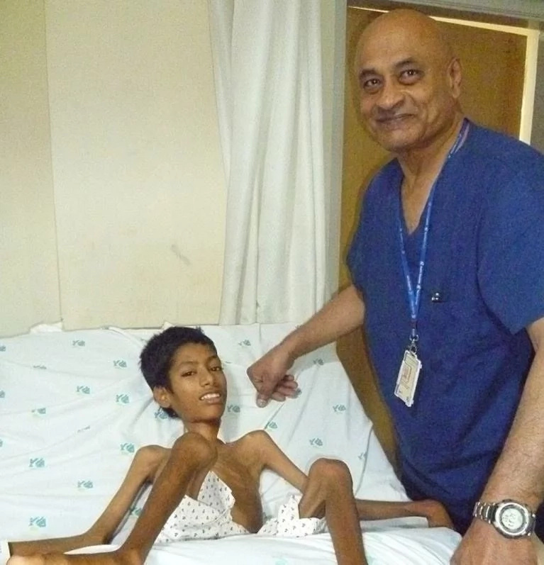 Mahendra and Dr Krishna who performed the ten-hour surgery