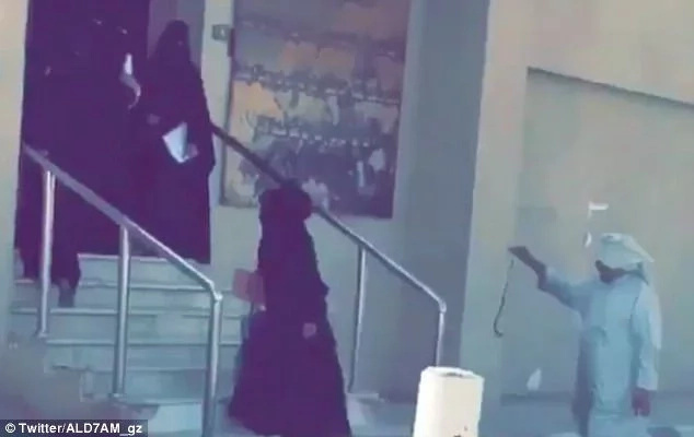 School guard uses cane and a SNAKE to group veiled female pupils (photos, video)