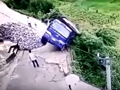Chinese Man Jumps Out Of Truck Moments Before It Falls Off A Cliff
