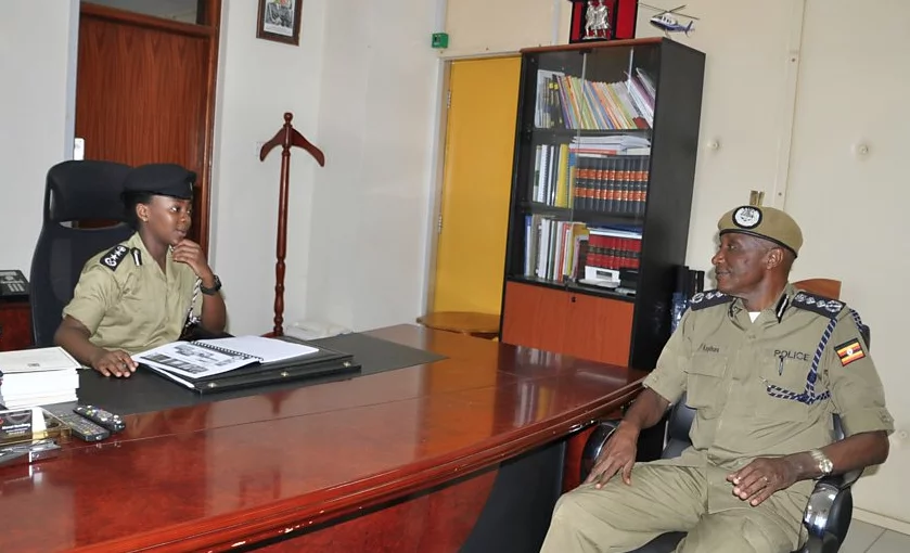 Atukunda (left) shadowed the chief of police (right) for a day. Photo: BBC