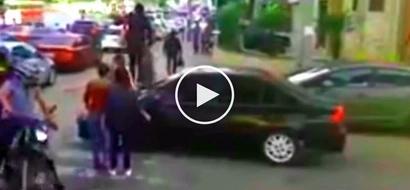 Furious pedestrians step on car hood after careless driver makes full stop over pedestrian lane