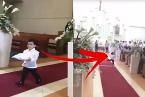This adorable ring bearer wins the Internet for his hilarious action