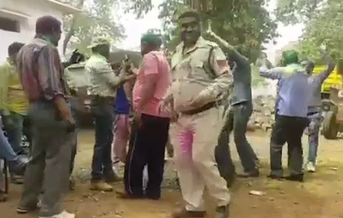 Confusion as policeman shoots HIMSELF in the head and dies during Holi celebrations (photo)