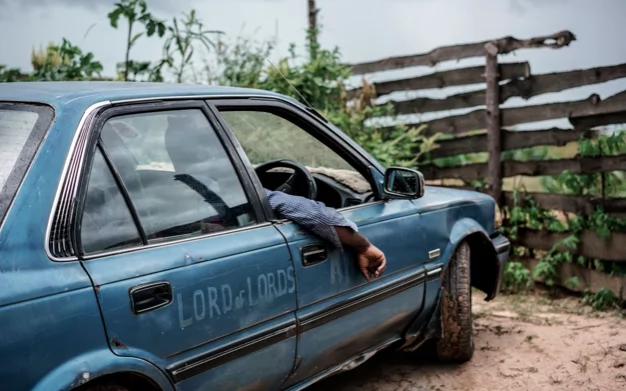 Jesus of Kitwe in his taxi. Photo: Telegraph/Jonas Bendiksen