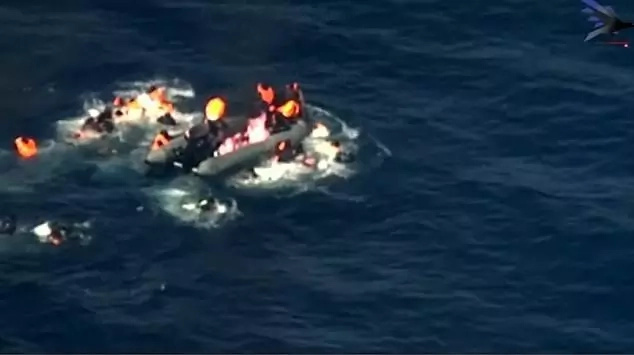 The migrants had to jump off when the fire started consuming their boat