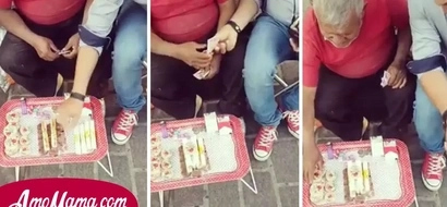 La reacción de un vendedor de dulces cuando un hombre se sentó a su lado y compró toda su mercancía