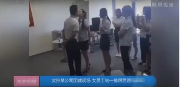 Chinese Boss Demands That His Female Workers Kiss Him On The Mouth, But Two Girls Refused...
