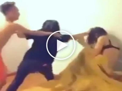 Heartbroken wife brutally assaults husband's mistress after catching them naked in bed together