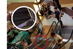 Girl got injuries while riding the escalator in Malaysian mall