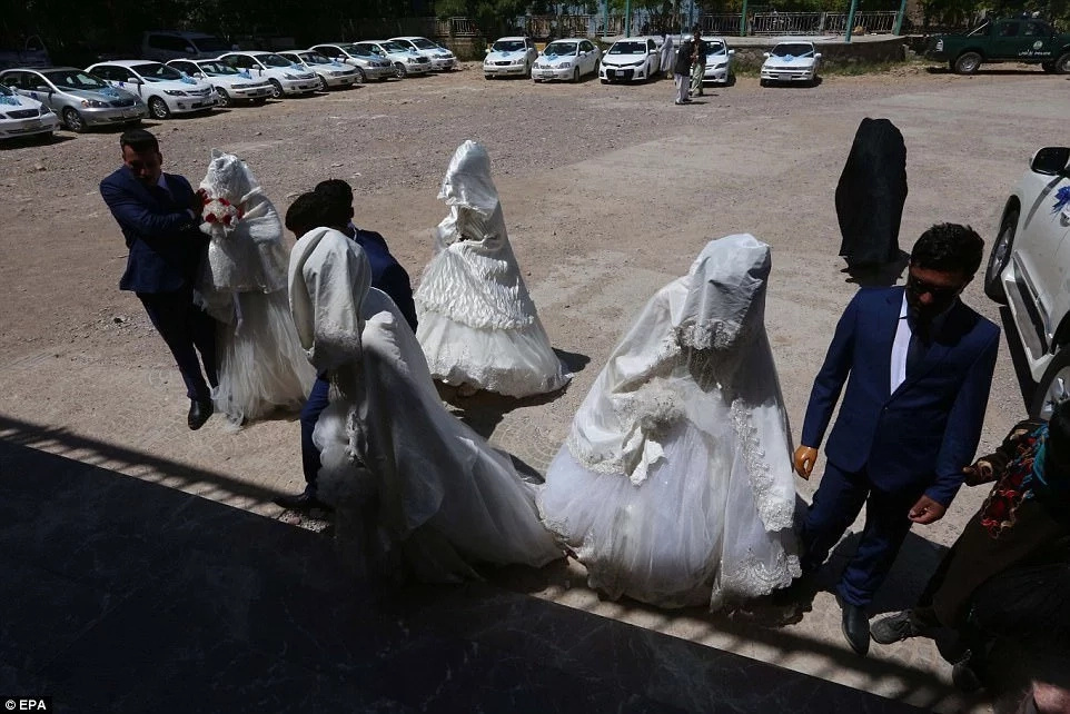 The couples arrive for the mass wedding