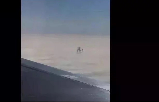 Plane passenger captured mysterious shadowy figure walking on clouds (photos)