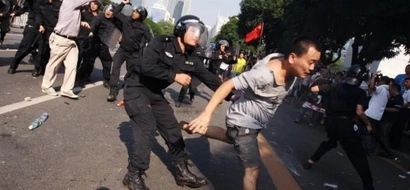 WATCH: Police hit unarmed protesters in China