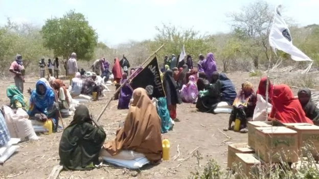 Al-Shabab militants distribute FOOD to drought-stricken areas to win public support